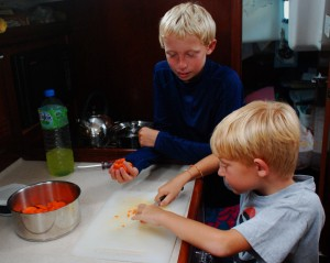 Bryson and Porter making dinner.  Working together as a family has become a joy and a source of pride for our children.